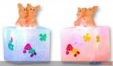 Glücksschweinchen auf LED-Präsentbox